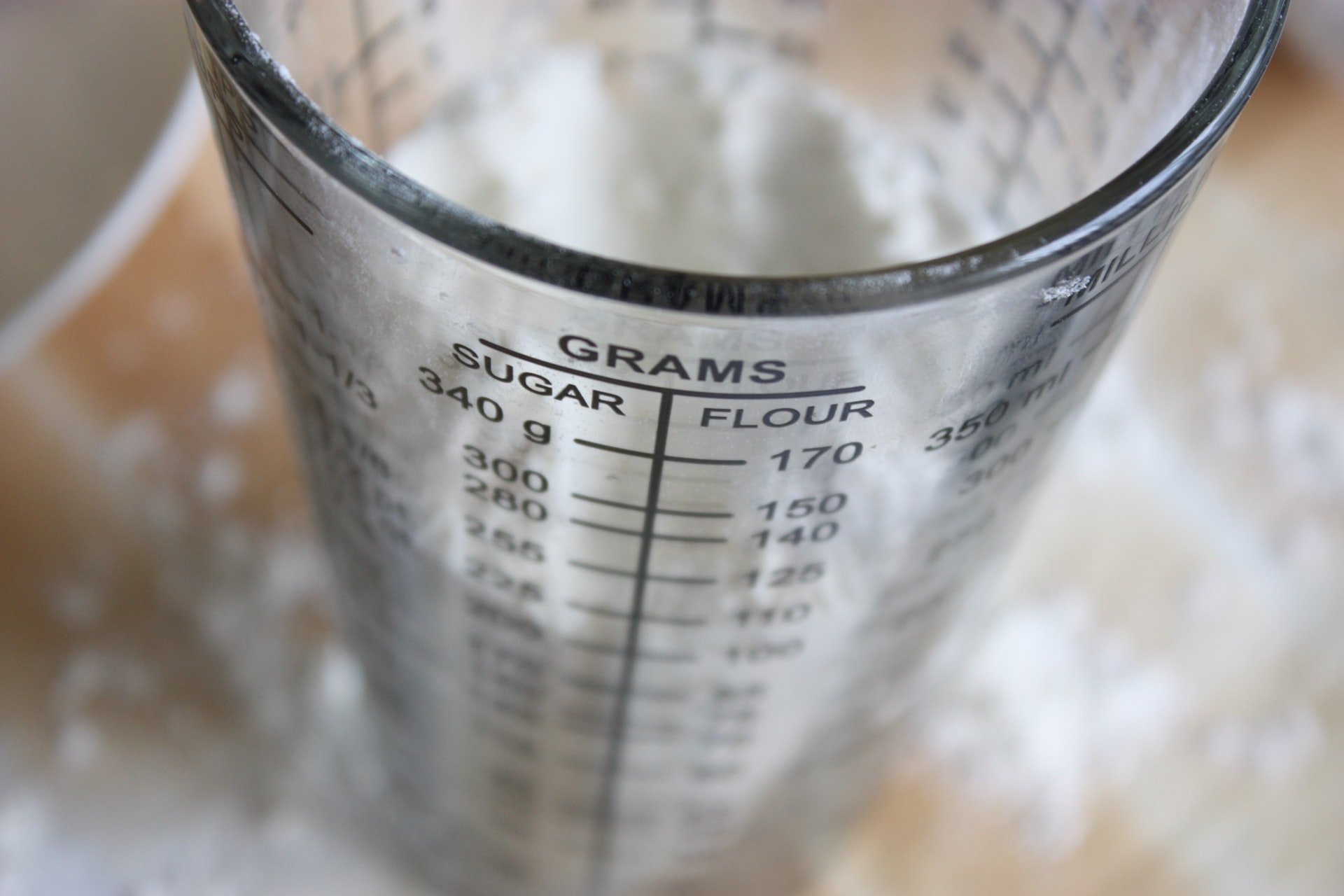 measuring beaker with sugar in it